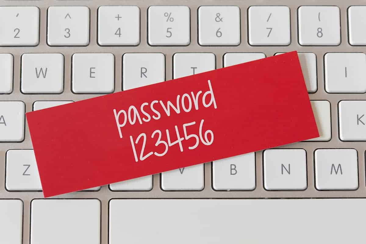 Password strength - password 123456 with white keyboard on background